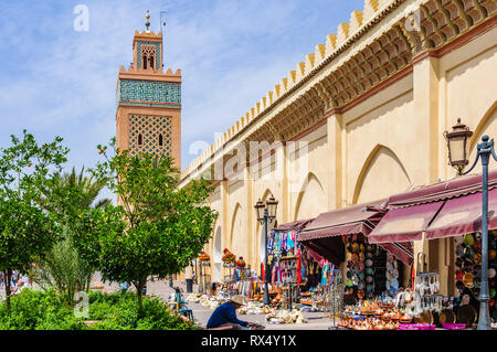Souvenir shops in front of Moulay El yazid Mosque in the Medina of Marrakech, Morocco - Stock Image