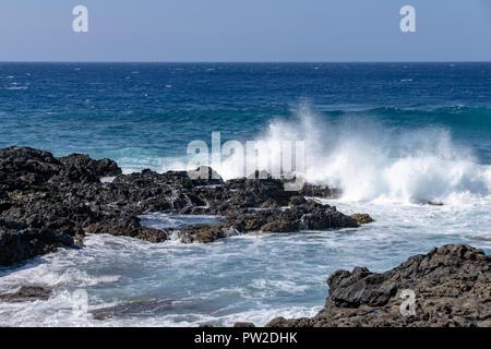 Atlantic ocean waves crashing over volcanic lava rocks on La Palma Island, Canary Islands, Spain - Stock Image