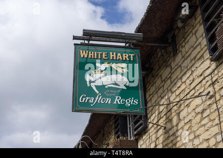 Pub sign for the White Hart, a traditional family run pub in the village of Grafton Regis, Northamptonshire, UK - Stock Image