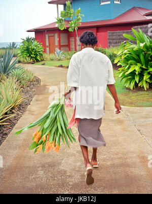 A maid carries flowers to a guest room at .Le Cap Est Lagoon Resort & Spa, Martinique,  Caribbean. - Stock Image