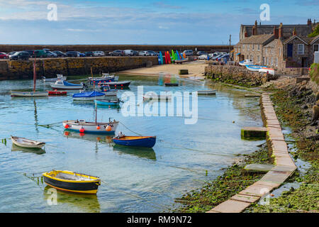 15 June 2018: Mousehole, Cornwall, UK - The harbour, and harbourside cottages. - Stock Image