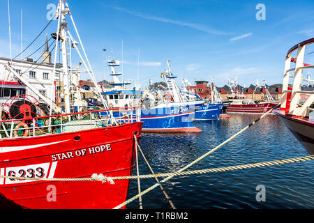 Killybegs, County Donegal, Ireland. 28th March 2019. Fishing boats in the harbour on a fine, warm day on the north-west coast.  Credit: Richard Wayman/Alamy Live News - Stock Image