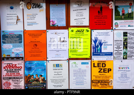 England, Berkshire, Goring on Thames, High Street, Village hall, noticeboard advertising forthcoming music events - Stock Image