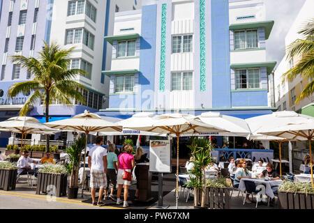 Miami Beach Florida Ocean Drive New Year's Day Art Deco District Casablanca Hotel sidewalk cafe restaurant umbrellas alfresco - Stock Image
