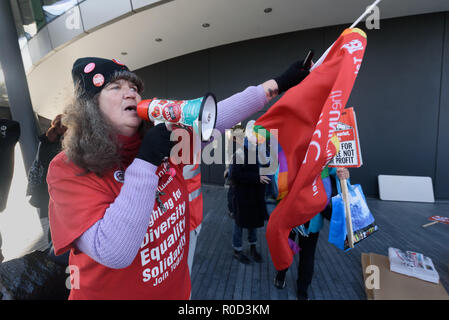 London, UK. 3rd November 2018. A Corbyn supporter argues with Class War who came to the 'No Demolitions Without Permission' housing protest at City Hall with banners declaring that Labour Councils were the biggest social cleansers in London and 'Labour, Labour Home Snatchers! Even Worse Than Maggie Thatcher', pointing out that it was largely Labour councils who were demolishing council estates so that developers could replace council houses with large numbers of properties sold at high market prices and a miserably small number of homes at social rent, promoting schemes which cut by thousands  - Stock Image