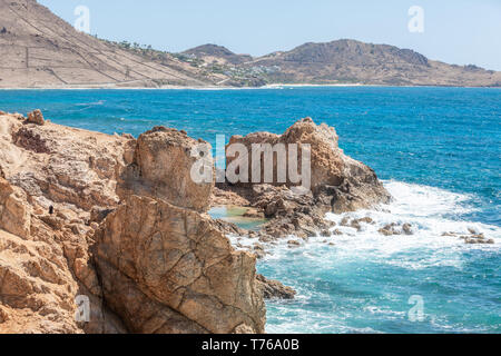 The rocky shore line of Grand Fond, St Barts - Stock Image