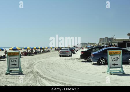 Cars parked on beach sand. Daytona Beach, Florida, USA - Stock Image