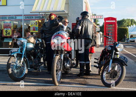 Chichester, West Sussex, UK. 14th Sep, 2013. Goodwood Revival. Goodwood Racing Circuit, West Sussex - Saturday 14th September. Rockers with their motorbikes congregate outside the vintage Tesco store across the road from the Mods. Credit:  MeonStock/Alamy Live News - Stock Image
