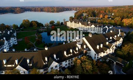 Aerial vista at sunrise over Elkhart Lake, The Osthoff Resort's reflecting pond during colorful autumn, Elkhart Lake, Wisconsin, USA. - Stock Image