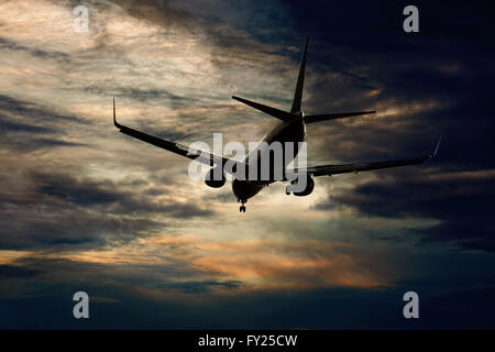 Passenger aircraft flying evening flight - Stock Image