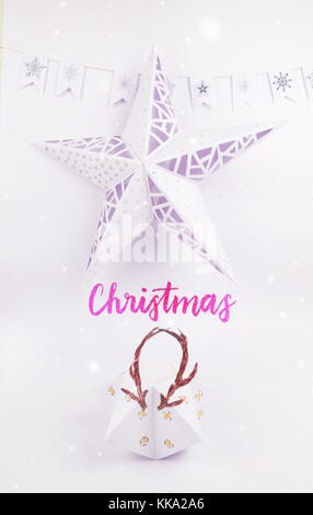 Christmas Decoration with star gift  box with deer horn christmas star and garland snow for holidays best background - Stock Image