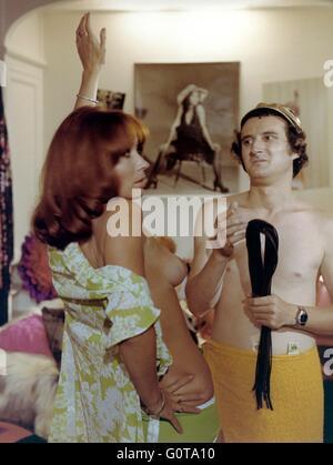 Marion Game and Daniel Prevost / La dernière bourrée à Paris / 1973 directed by Raoul André - Stock Image