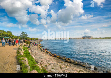 Tourists on holiday visit the Little Mermaid statue on the Langelinie promenade in Copenhagen, Denmark - Stock Image