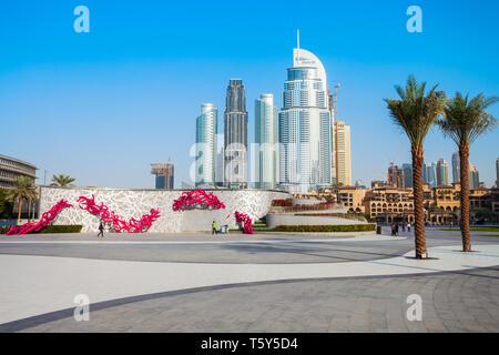 DUBAI, UAE - FEBRUARY 24, 2019: Promenade near the Burj Khalifa Tower and Dubai Mall in Dubai city in United Arab Emirates - Stock Image