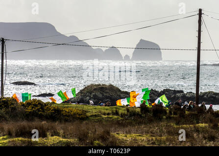 Rosbeg, County Donegal, Ireland. 17th March 2019. People march to commemorate St. Patrick's Day in the small fishing village on the north-west coast. Credit: Richard Wayman/Alamy Live News - Stock Image