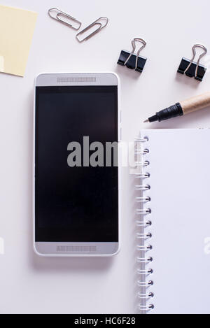 Mobile phone and note book. Office concept - Stock Image