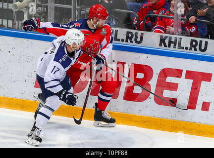 Moscow, Russia. 21st Mar, 2019. MOSCOW, RUSSIA - MARCH 21, 2019: HC Dynamo Moscow's Juuso Hietanen (L) and HC CSKA Moscow's Jannik Hansen in action in Leg 5 of their 2018/19 KHL Western Conference semi-final playoff tie, at CSKA Arena. Mikhail Tereshchenko/TASS Credit: ITAR-TASS News Agency/Alamy Live News - Stock Image