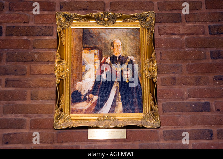 Pictures of HRH hanging inside a freemason masonic lodge - Stock Image