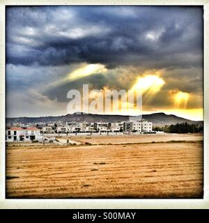 View towards Oriklini, Larnaca on Cyprus in dramatic late afternoon light. - Stock Image