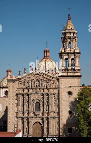 The Baroque Churrigueresque style Iglesia del Carmen church and convent in the historic center on the Plaza del Carmen in the state capital of San Luis Potosi, Mexico. - Stock Image