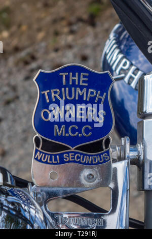 The Triumph Motor Cycle Club owners badge with motto Nulli Secundus at a club meeting in North Yorkshire England UK - Stock Image