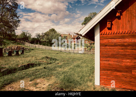 old farm houses in a rural landscape - Stock Image