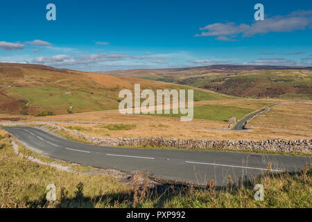 Yorkshire Dales National Park autumn landscape, down into Swaledale on the Buttertubs Pass - Stock Image
