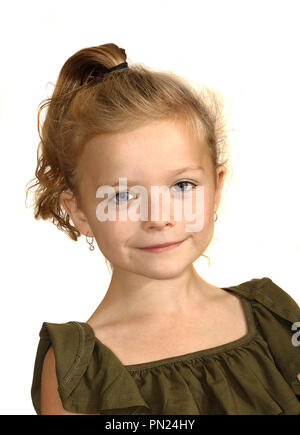 Six year old girl smiling at camers - Stock Image