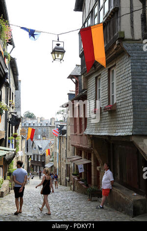 View of street and tourists in summer, Rue de la Lainerie, Dinan, Cotes d'Amor, Brittany, France - Stock Image