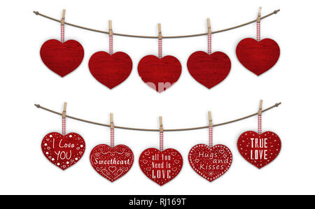 cute red wooden hearts hanging on clothes pegs, blank and decorated with text  I love you, isolated on white background - Stock Image