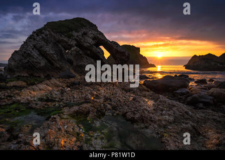 Sea arch in Ballintoy , County Antrim - Northern Ireland - Stock Image
