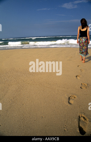 Girl walking on pristine beach in Mozambique - Stock Image