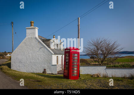Crofters cottage and phone box, Loch Ewe, Poolewe, west coast of Scotland. - Stock Image