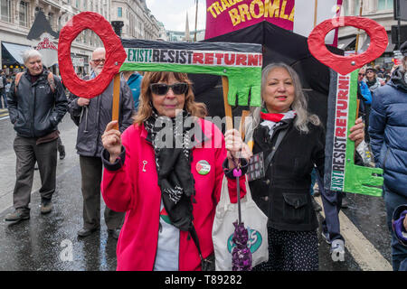 London, UK. 11th May 2019. Two women hold giant keys in the colours of the Palestinian flag on the march from the BBC to a rally in Whitehall a few days before Nakba day showing solidarity with the Palestinian people and opposing continued Israel violation of international law and human rights. The protest called for an end to Israeli oppression and the siege of Gaza and for a just peace that recognises Palestinian rights including the right of return. It urged everyone to boycott and divest from Israel and donate to medical aid for Palestine. Peter Marshall/Alamy Live News Credit: Peter Marsh - Stock Image