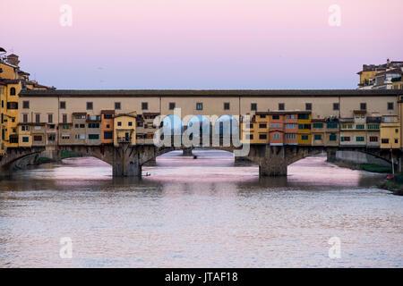Ponte Vecchio at sunrise, UNESCO World Heritage Site, Florence, Tuscany, Italy, Europe - Stock Image