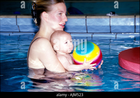 Mother with baby boy in indoor swimming pool Denmark - Stock Image