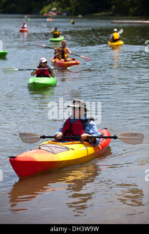 Kayakers paddling on a lake in Bella Vista, Arkansas, USA. - Stock Image