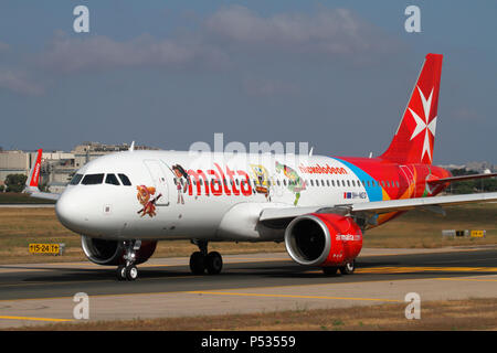 Air Malta Airbus A320neo passenger jet plane taxiing for departure. Front quarter view emphasising the enlarged engine nacelles of the Neo. - Stock Image