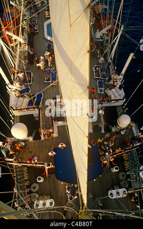 Star Flyer (one of the Star Clippers' ships). Passengers are often allowed to climb the masts of the Star Flyer, - Stock Image