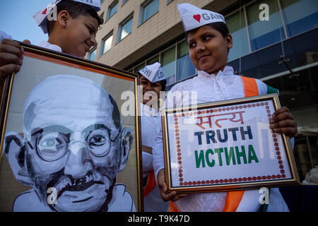 A performance of the Indian Embassy on Sakharov Avenue in Moscow is dedicated to the 150th anniversary of the birth of Indian politician Mahatma Gandh - Stock Image