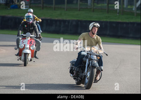 Chichester, West Sussex, UK. 14th Sep, 2013. Goodwood Revival. Goodwood Racing Circuit, West Sussex - Saturday 14th September. Biker dressed as Chino from The Wild One takes part in the track parade of mods, rockers and police. Credit:  MeonStock/Alamy Live News - Stock Image
