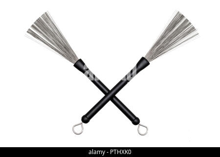 pair of crossed drum brushes on white background - Stock Image