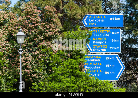 Road signs and street lamp, Kykkos, Troodos Mountains, Limassol District, Republic of Cyprus - Stock Image