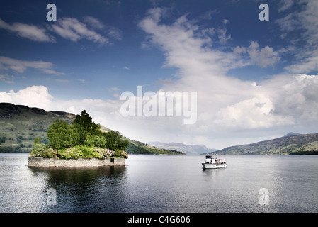 boat sailing on a loch in Scotland - Stock Image