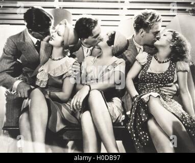 Three couples kissing - Stock Image
