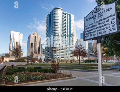 CHARLOTTE, NC, USA-1/8/19: Romare Bearden Park & informational sign about the artist for whom the park was named. - Stock Image