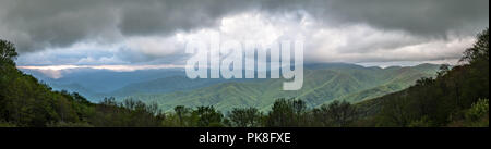 Early Sunset Light Breaks Through Clouds Over Blue Ridge Mountains Panorama - Stock Image