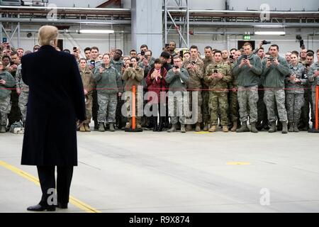 U.S. President Donald Trump addresses U.S. service members during stop-over at Ramstein Air Force Base following a surprise visit to Iraq December 26, 2018 in Ramstein-Miesenbach, Germany. The president and the first lady spent about three hours on Boxing Day at Al Asad, located in western Iraq, their first trip to visit troops overseas since taking office. - Stock Image