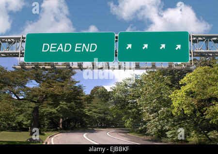 Dead End written on overhead highway sign - Stock Image