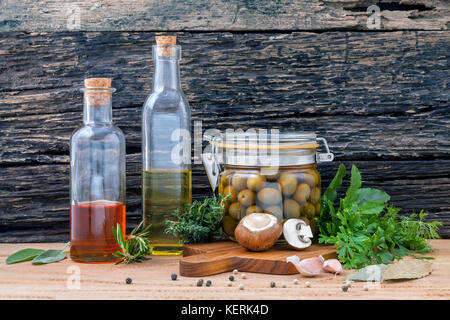Different sorts of cooking oil,olive oil flavored and Sesame oil with spices herb rosemary ,thyme,dill,sage and - Stock Image